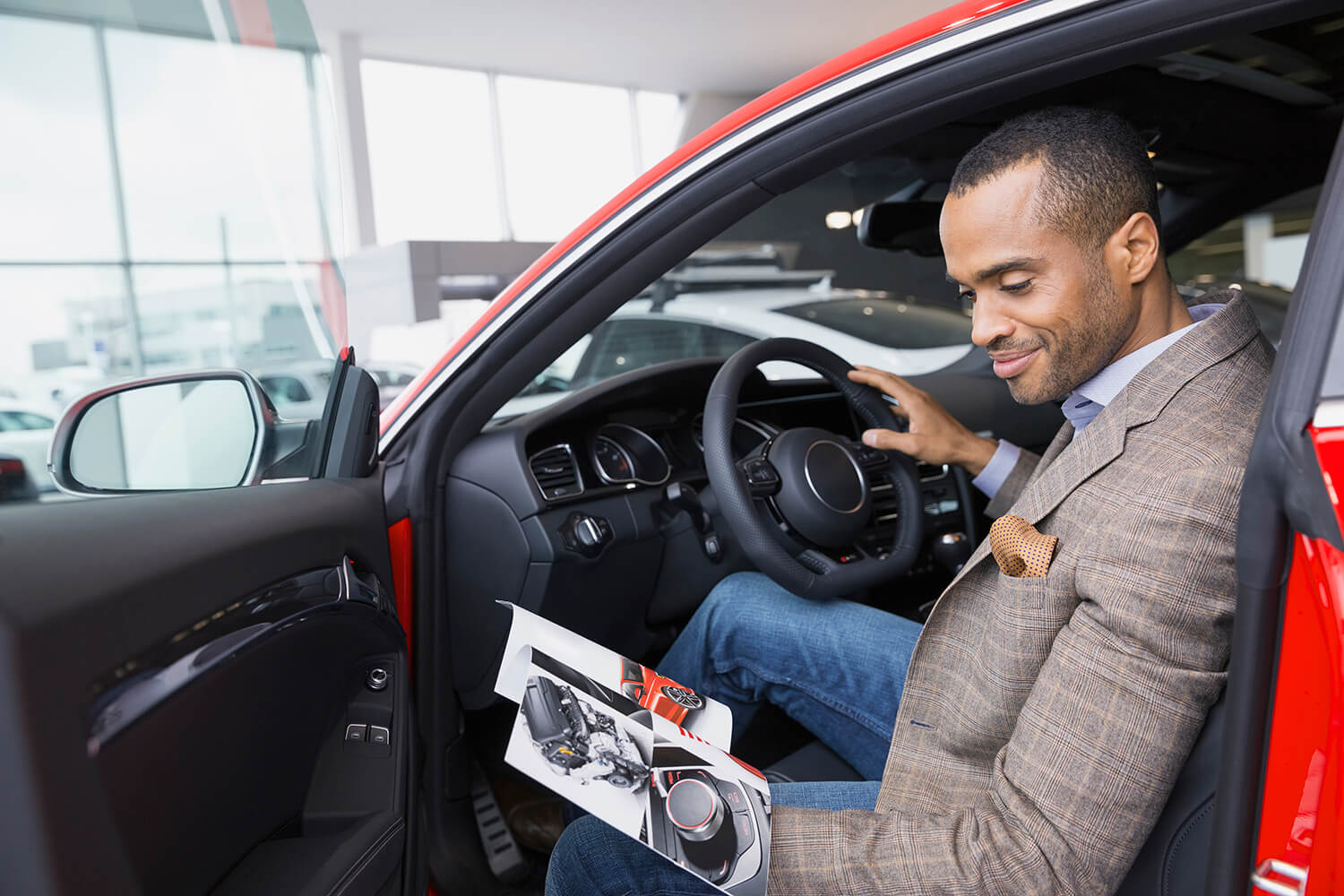 Man in car contemplating getting an online car loan