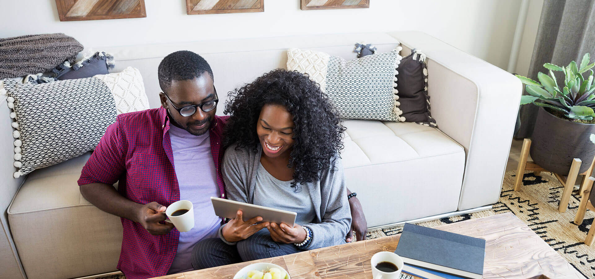 Couple looking at tablet discussing opening up an Alliant high interest checking account