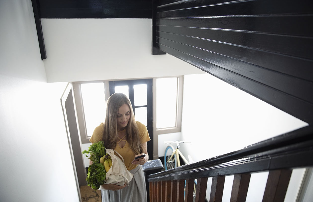 Woman walking into apartment