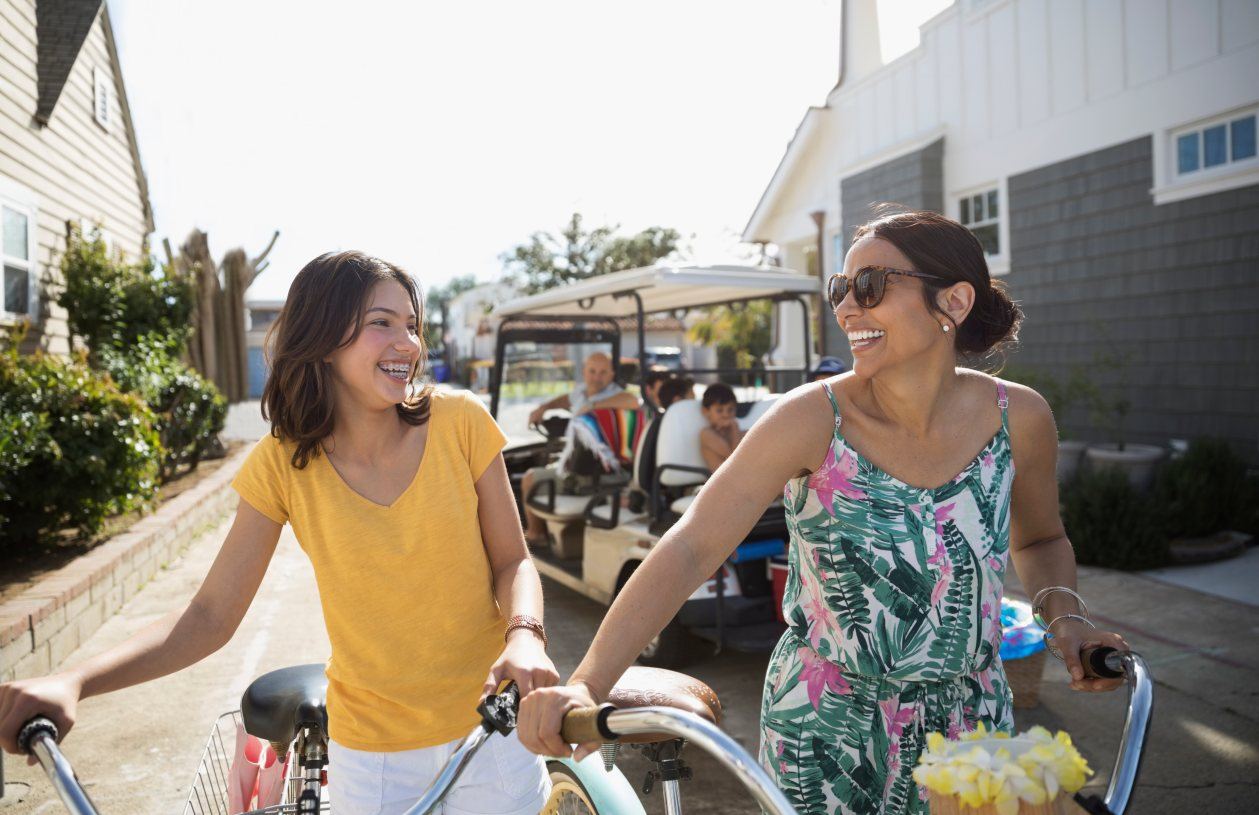 Mom and daughter talk about money while biking